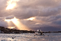 Sunbeams after a storm over Seal Island, South Africa